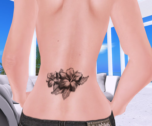 Lower back wing tattoos for girls