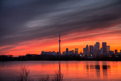 Toronto Sunset HDR (Dr. Ilia) Tags: sunset sky toronto ontario canada reflection water canon evening spring downtown april orangesky 2009 soe wardsisland lesliestreetspit torontodowntown 50d topshots mywinners abigfave platinumphoto anawesomeshot flickrdiamond theunforgettablepictures theperfectphotographer skyascanvas outerharboureastheadland