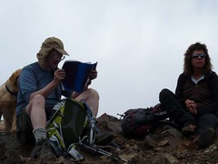 Jim K studying the summit register - Elle contemplating ????