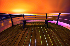 A Distorted View of the World (dan barron photography - landscape work) Tags: wood longexposure nightphotography light orange seascape bench pier ominous magenta saltburn barreldistortion sigma1020mm nikond90 danbarron