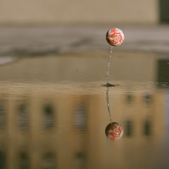 Mr. Bouncy Ball! (moiht) Tags: reflection water speed ball puddle shutter bounce bouncy overtheexcellence