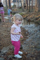 Catie throwing rocks in the creek