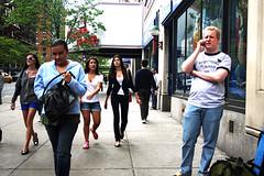 On a Sidewalk (wyojones) Tags: newyorkcity girls newyork men guy sunglasses women manhattan telephone expressions cellphone newyorker purse behavior brunettes yorkville uppereastside wyojones