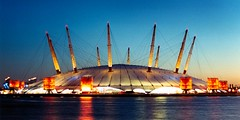 UK - London - The Dome at dusk - panorama (Darrell Godliman) Tags: uk greatbritain travel sunset england panorama copyright building london tourism thames architecture night arquitectura europe tramonto sonnenuntergang unitedkingdom britain dusk widescreen eu engineering panoramic nightime dome gb architektur docklands puestadesol bluehour masts riverthames  modernarchitecture architettura magichour floodlit allrightsreserved architectuur coucherdesoleil theo2 regeneration mimari millenniumdome tensile richardrogers gnbatm  thedome contemporaryarchitecture  ptfe greenwichpeninsula   richardrogerspartnership tensilestructure instantfave o2dome omot  rogersstirkharbourpartners flickrelite themillennium dgphotos darrellgodliman wwwdgphotoscouk dgodliman millenniumexperience  uklondonthedomeatduskpanorama tensilearchitecture