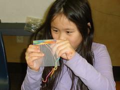 Sophia Making a Needlepoint Coaster