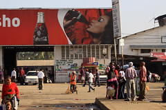 Cocacola Ads :( (Mehdi Kavousian) Tags: africa street red people man color bus tanzania women african cocacola arusha streetshot adverstisement         africanwoman  africanman  ternimal  colorsofafrica darosalam
