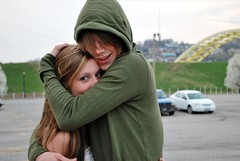 (Leigh Ellexson) Tags: bridge boy blur green cars girl grass outside hoodie hug kentucky newport hood poarkinglot