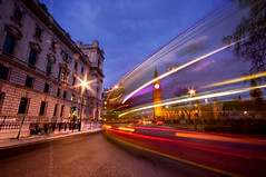 (Claire Hutton) Tags: city uk longexposure red england urban motion bus london westminster night buildings dark lights movement twilight traffic trails parliament bigben clocktower bluehour whitehall traffictrails