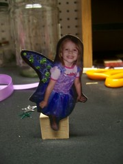 little fairy embellished with glitter and guled to a block