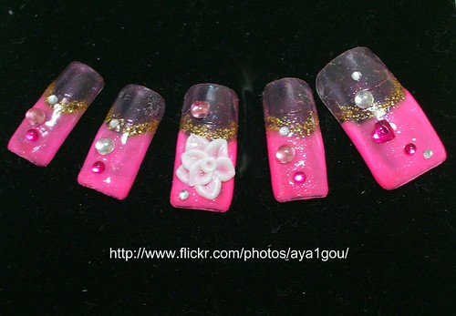 Pink artificial nails design with black background