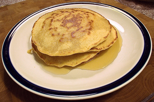 corn meal pancakes with maple syrup