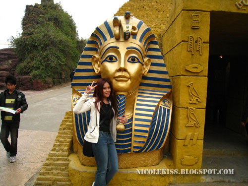 posing with an egyptian statue
