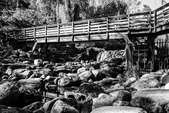 Edwards Gardens rockscape (PJMixer) Tags: park bridge bw toronto gardens landscape waterfall nikon rocks stream