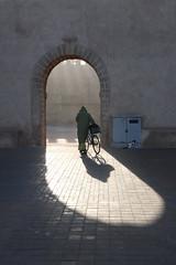 (atomareaufruestung) Tags: africa morning winter shadow bicycle backlight port cat sunrise work walking morninglight gate alone loneliness muslim january oldman morocco walker medina afrika invierno lonely katze tor hafen schatten essaouira marokko januar mogador 2014 djellaba