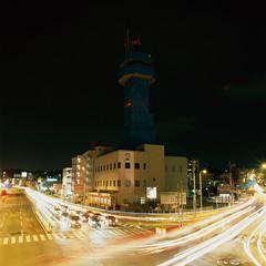 a covered tower at Ojana crossroads by Akira ASKR - 沖縄県宜野湾市、大謝名交差点