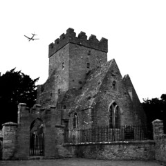 St Doolagh's with plane (Dave Road Records) Tags: churches stoneroof malahide stonechurch irishchurch doulaghs stdoulaghs stdoolaghs doolaghs saintdoolaghs