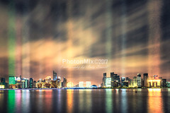 Powered Up (Andy Brandl (PhotonMix)) Tags: asia cityscape futuristic processing night longexposure china photonmix skyscrapers beamsoflight river reflections movingclouds modern