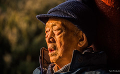 2016 - China - Beijing - Senior - 3 of 6 (Ted's photos - Returns 23 Jun) Tags: 2016 beijing china cropped nikon nikond750 nikonfx tedmcgrath tedsphotos vignetting bokeh male man oldman toque hat cap face portrait profile jacket zipper beijingchina senior