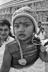 Pom Poms (alisdair jones) Tags: ef35mmf14lusm girl child portrait hat pompoms bindi ruwanwelisaya anuradhapura srilanka