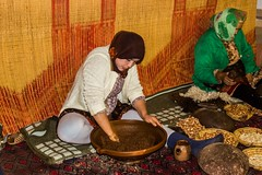 Hard at work making Argon Oil (Shelbypoppit) Tags: life africa street city light portrait mountains landscape photography interesting cityscape market muslim spice working culture mosque morroco camel busy maroc atlas marrakech souk medina marrakesh souks smelly marroc riad low cinamon peaple kniza light north africa