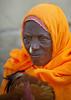 Eritrean Woman With Gold Nose Ring, Adi Keyh, Eritrea (Eric Lafforgue) Tags: africa people orange yellow vertical outdoors gold women veil adult headscarf earring nosering adultsonly oneperson onepeople eritrea hornofafrica traditionalclothing realpeople colorimage onewomanonly eritreo erytrea eritreia colourimage africanethnicity 1people إريتريا ertra 厄利垂亞 厄利垂亚 エリトリア eritre eritreja eritréia эритрея érythrée africaorientaleitaliana ερυθραία adikeyh 厄立特里亞 厄立特里亚 에리트레아 eritreë eritrėja еритреја eritreya еритрея erythraía erytreja эрытрэя اريتره אריתריה เอริเทรีย ert5640