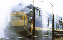 CSX GE U23B locomotive # 3323 is seen while passing through the last stages of high pressure spray washer in the Uceta Railroad Yard at Tampa, Florida, 1989 9 of 11 (alcomike43) Tags: old color classic water yard vintage photo diesel tracks engine slide trains spray historic photograph rails locomotive freighttrains ge railroads generalelectric rightofway csx dieselengine tampaflorida railroadyard diesellocomotive 3323 dieselelectriclocomotive u23b ucetarailroadyard locomotivewasher highpressurewaterjetspraywasher