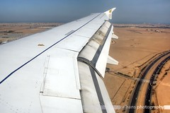 Gulf Air - A319-100 (raihans photography) Tags: canon eos inflight wing aerialview aerial airbus kuwait dslr approach canondslr efs gf a319 gulfair kwi goldenfalcon wingview kuwaitinternationalairport a319100 canonefs okbk canonefslens canonefs1855mmf3556is 1000d canoneos1000d raihans raihanshahzad raihansphotography