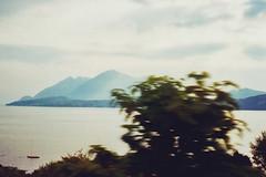 (LICHTHOF-CM) Tags: italien light summer italy sun mountain lake alps film nature water sunshine clouds analog canon photography see europe italia kodak berge alpen lichthof 2013 laggo af35 lichthoftumblrcom