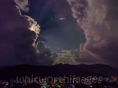 The moon emerges (whitworth images) Tags: city nepal sky moon weather night clouds stars lights asia southeastasia hills monsoon cumulus rays pokhara buidings kaski