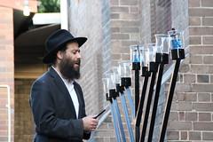 Davening or pained (bobmendo) Tags: beard synagogue rabbi lighter newtown hanukkah menorah hanukkiah 9branched