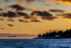 Silver Harbour (Doguu) Tags: winter sunset lake snow canada cold ice water sunrise rocks freezing shore lakesuperior islet thunderbay northernontario silverharbour