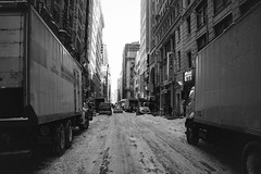 *** (Justin Wolfe) Tags: road park street city nyc newyorkcity winter urban blackandwhite snow cinema newyork cold building cars ice window monochrome weather skyline architecture modern truck canon dark movie lights graffiti alley downtown cityscape centercity snowy widescreen grain citylife streetphotography monotone sidewalk classical cinematic tagging hirise urbex t2i