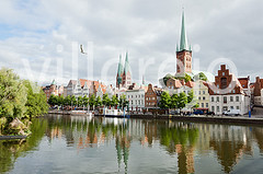 Skyline of Lubeck city (Villorejo) Tags: old city house reflection tourism church water skyline architecture germany harbor north wave medieval placesofworship luebeck lubeck channel brickstone famousplace architectureandbuildings architecturebackgrounds