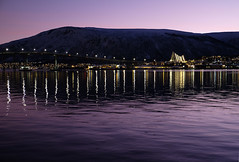 Purple Sunset and the Arctic Cathedral in Norway (` Toshio ') Tags: city bridge mountain reflection church norway lights europe european purple or arctic norwegian arcticcircle tromso troms romsdalen troms toshio tromsdalen tromsdalenkirke xe2 arcticchurch tromsysund tromsysundkirke fujixe2