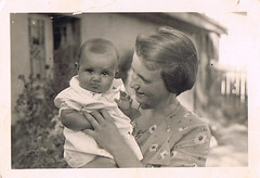 Smiling? Me? No! (TrueVintage) Tags: bw baby cute 1930s funny mother oldphoto sw past mutter motherchild foundphoto sss niedlich 1935 vergangenheit vintagephoto mutterkind vintagebaby