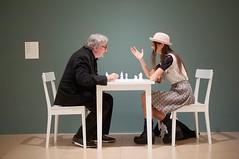 White Chess Set 1966-2013. Jon Hendricks, the Guggenheim exhibition curator plays against Yoko Ono's assistant Gabriella Daris. Photograph_David Hornback for the Guardian