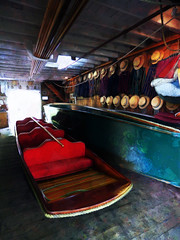 Inside the Antigua Boat Sheds (Steve Taylor (Photography)) Tags: punt boater hat boat pole antiguaboatsheds seats flatbottomed coat shed garage art digital red blue green brown white fun wood newzealand southisland nz canterbury christchurch city river avon perspective texture jacket light floorboard