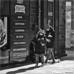 Read all about it (John Riper) Tags: johnriper street photography straatfotografie square vierkant bw black white zwartwit mono monochrome netherlands candid john riper xt1 fuji 18135 people coolsingel volkskrant algemeen dagblad newspaper kids nieuwvlees girl boy