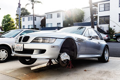 Slumming (larryvincent) Tags: ca usa cars foil santamonica disabled bmw blocks