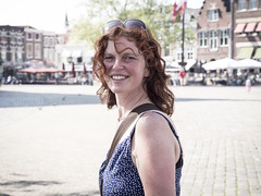 Hanneke, Gouda 2013: Quick-snapping that smile (mdiepraam) Tags: portrait woman beautiful smile dutch pretty gorgeous curls redhead mature attractive hanneke marketsquare gouda fortysomething 2013
