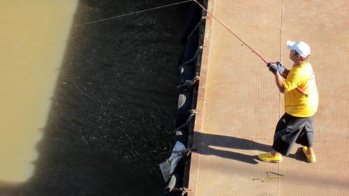 Men fishing at Phranang Klao Bridge