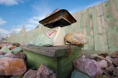 grasshopper and the rock farm (krugerlive) Tags: scale southdakota nikon rocks wideangle roadtrip grasshopper 28 roadside 1424mm