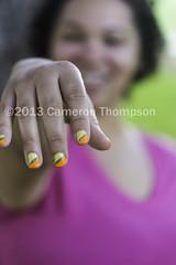 She likes nail polish (SW23CT (CamsDigitalCanvas.com)) Tags: california pink orange woman white black cute green girl beautiful smile yellow female hands pretty bokeh fingers polish nails fingernails nailpolish camarillo mixedrace nikond7100