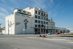 Historic Building of Gore (Jocey K) Tags: newzealand sky signs cars clouds buildings lights town artwork railway nz gore southisland flemingscreamoatamill