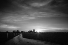 long lane (Jen MacNeill) Tags: road sunset blackandwhite bw sun clouds barn drive evening driving pennsylvania path farm silo amish pa lane lancaster sunburst lancastercounty sunbeams