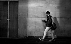 2017_72 (Chilanga Cement) Tags: fuji fujix100t fujix100f x100t xseries x100s x100 x100f bw blackandwhite daylight lightroom monochrome people friargate man boy walking candid sunlight phone