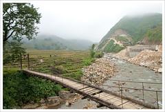 Bridge over rocky river (Tuomas A. Lehtinen Photography) Tags: bridge canon river landscape eos asia view rice terrace hill foggy rocky vietnam sapa 1755mm 400d
