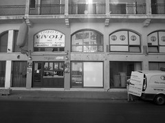 Vivoli Creperie Coca Cola! Larnaca, Cyprus (Fanny Janssen OAP) Tags: street city windows light man pancakes reflections greek hotdog arm cola streetphotography cyprus crepe van highstreet coca vivoli crepoli