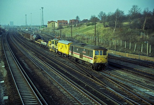 73130 passes Grove Park with a mixed engineers train on 29-1-92. Copyright Ian Cuthbertson