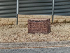 I didn't dare look inside (mikecogh) Tags: abandoned mystery corner fence chest curious unusual left wicker